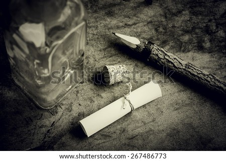 message in a bottle, written message on paper for put in the glass bottle over grunge background. - stock photo