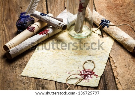 Message in bottle with a sealed message on old paper - stock photo