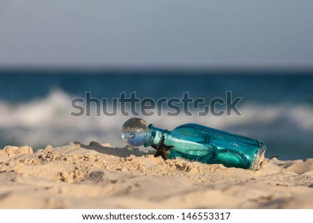Message in the bottle on the shore of the Caribbean sea. Summer beach background. - stock photo