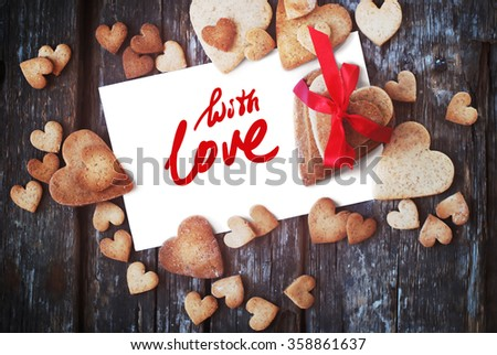 Message With Love on the White Isolated Letter and Gingerbread Cookies in the Shape of Heart at Valentine Day. Selective focus - stock photo