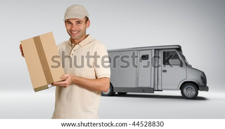 Messenger delivering a parcel with a delivery back in the background - stock photo