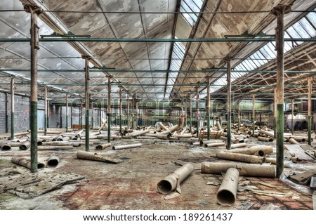 Messy abandoned warehouse, hdr processing - stock photo