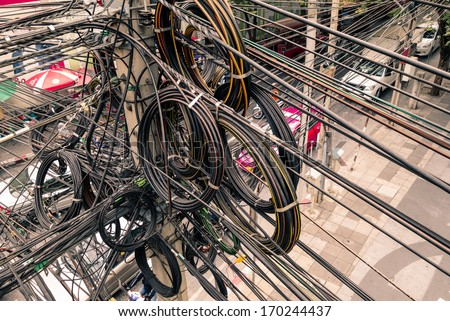 Messy electrical cables in Bangkok city - stock photo