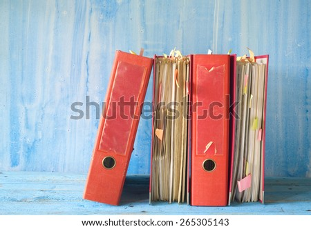 messy file folders, free copy space - stock photo