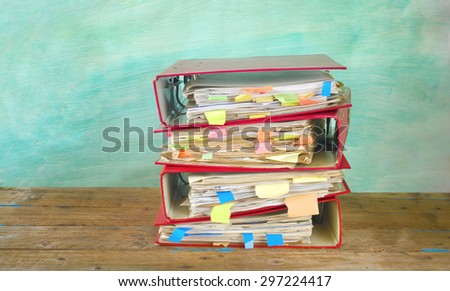 messy file folders on grungy background, free copy space - stock photo