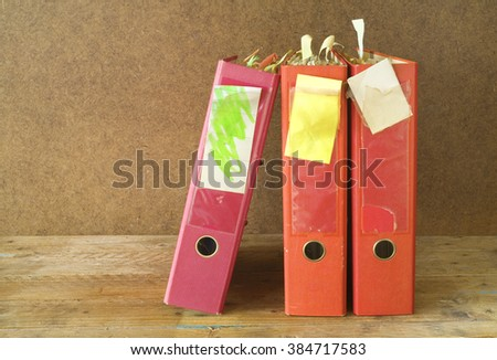messy file folders with old documents, free copy space - stock photo