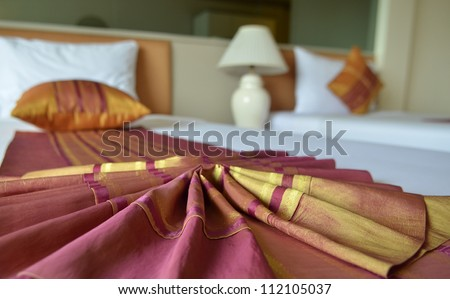 Messy luxurious bed with pillow and quilt cover - stock photo