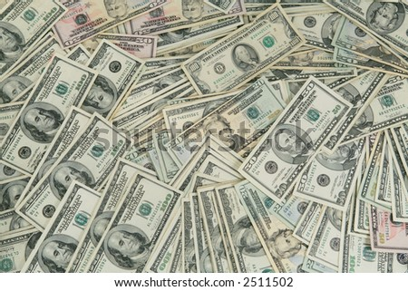 Messy pile of one hundred,fifty and twenty dollar bills - stock photo