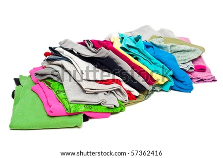 messy pile of woman clothes - stock photo