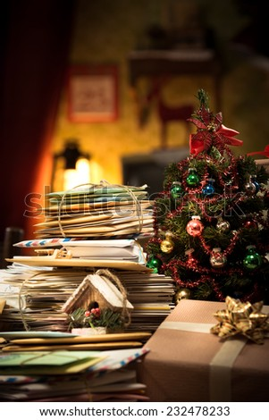 Messy Santa Claus home with lots of mail letters and Christmas tree on foreground - stock photo