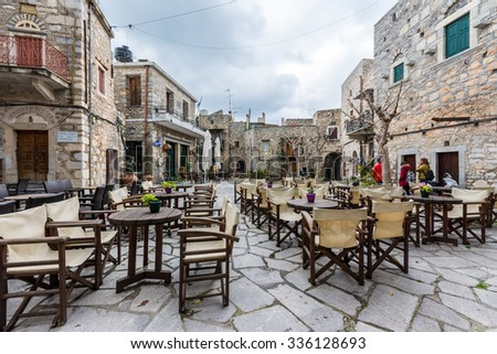 MESTA,CHIOS ISLAND, GREECE- MARCH, 2015: Mesta village square in Chios Island, Greece on March 14,2015. The village of Mesta is the most distant of the medieval villages. - stock photo