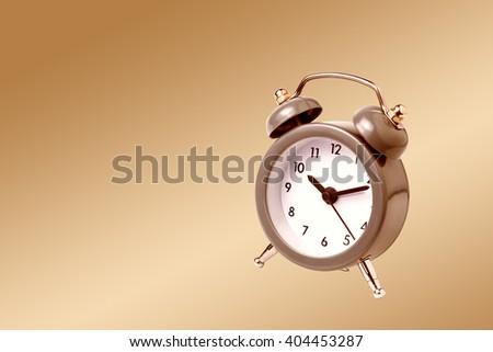 Metal Alarm clock work time 10 am. - stock photo