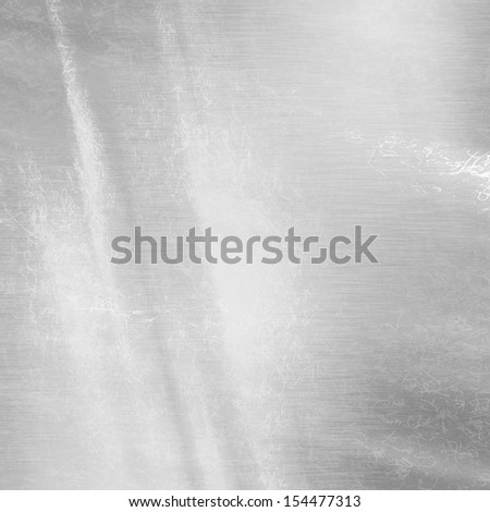 metal background texture with some shades and highlights on it - stock photo