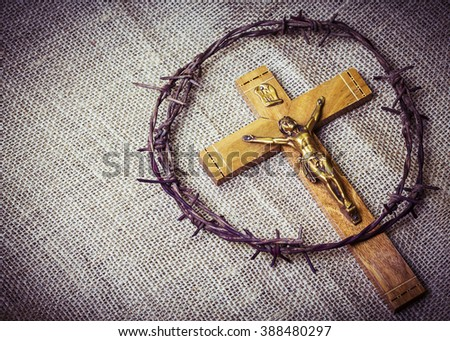 metal Barbed Wire made like the crown of thorns of Jesus on sack cloth background,  can be used for Christian concept , Easter concept, copy space - stock photo