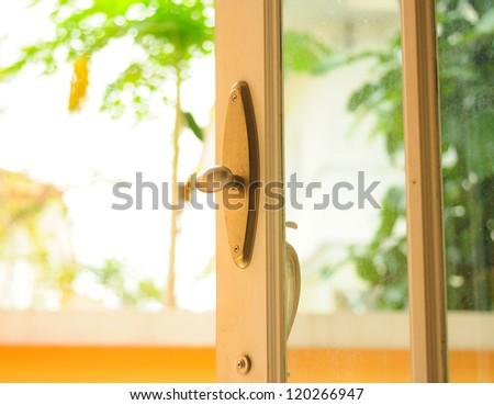 Metal Brass Door Knob Open House - stock photo