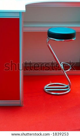 Metal chair in a red interior - stock photo