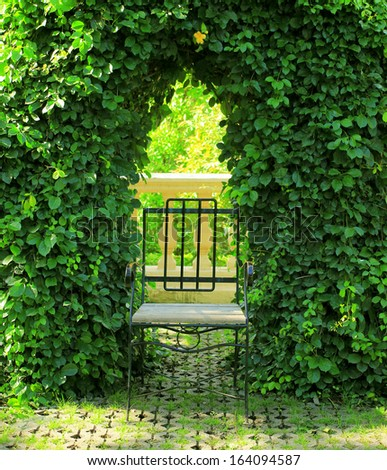 Metal chair in the garden - stock photo