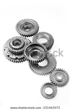 Metal cog gears joining together  - stock photo