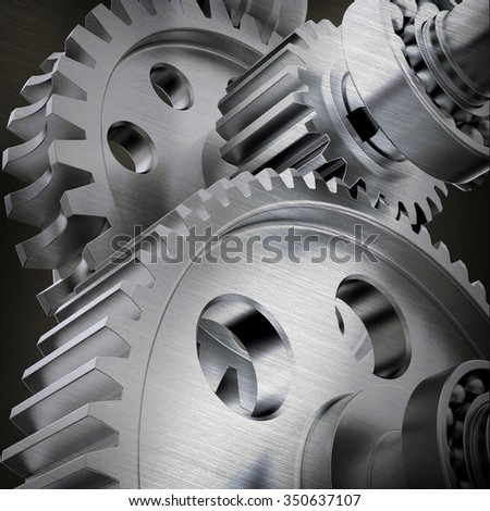 Metal cog gears joining together, close up view - stock photo