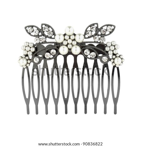 Metal comb barrette isolated on white - stock photo