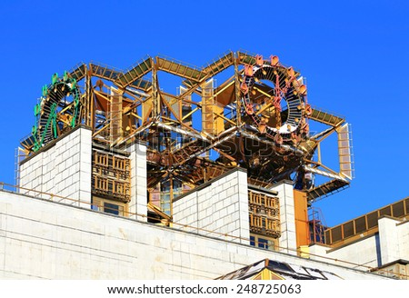 Metal composition on the space theme on the building of the Academy of Sciences in Moscow - stock photo