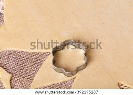 Metal cookie cutter on fresh dough. Macro. Photo can be used as a whole background. - stock photo