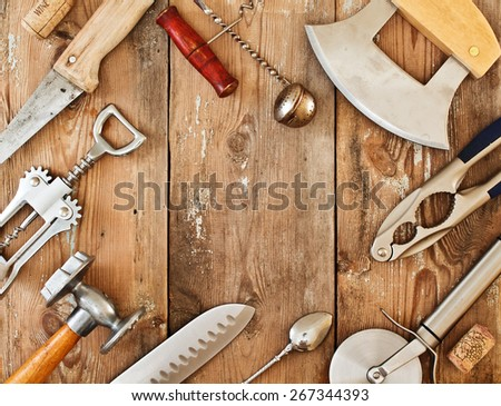 Metal cookware and accessories on a wooden table. Frame with kitchen accessories - stock photo