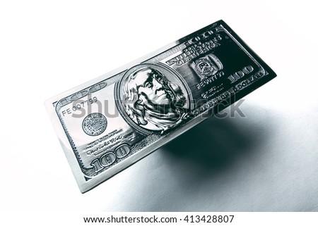 Metal copy hundred dollar bill closeup. Benjamin Franklin on the metal banknote. - stock photo