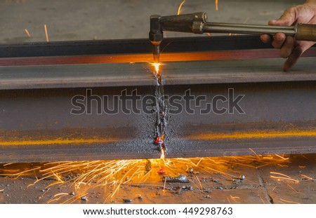 Metal cutter, steel cutting with acetylene torch, industrial worker on manufacturing area. - stock photo