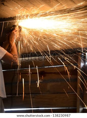 metal cutting grinder in dark garage - stock photo