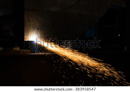 Metal Cutting large steel with Plasma cutters in dark - stock photo