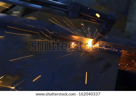 metal cutting with acetylene torch, industrial background - stock photo