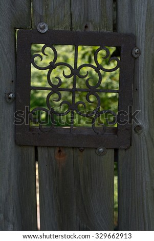 Metal Design Window Looking into the Garden - stock photo