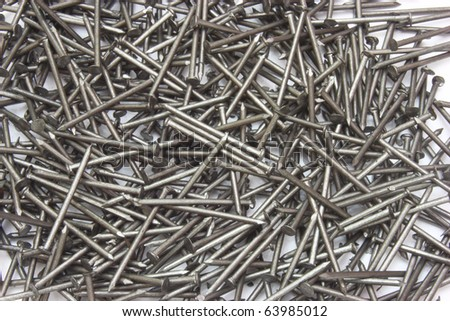 metal different nails on white background - stock photo