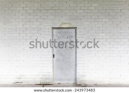 Metal door industrial building dirty - stock photo