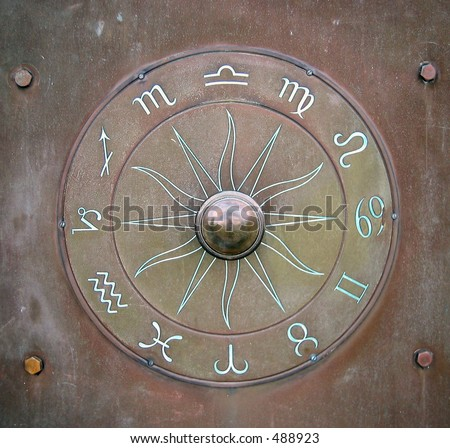 Metal door with zodiac decoration - stock photo