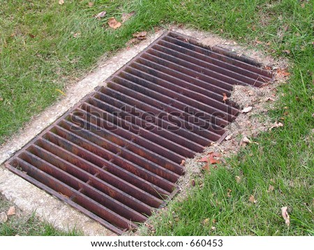 Metal Drainage Grate in Lawn - stock photo