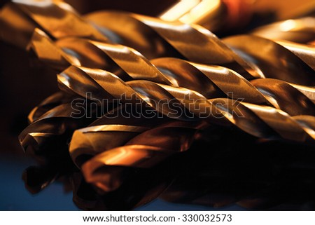 Metal drill bits. Drilling and milling industry. Macro image. - stock photo
