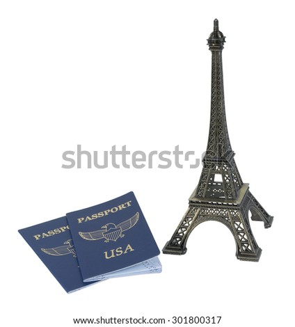 Metal Eiffel Tower model and a traveling passport - path included - stock photo