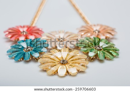 metal feminine necklace. in the form of flowers - stock photo
