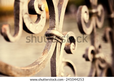 Metal fence detail. Abstract concept. Vintage color post processed - stock photo