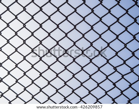 metal fence grid. - stock photo