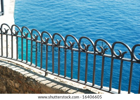 Metal fence on the coast in Monte-Carlo - stock photo