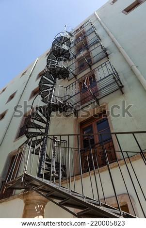 metal fire escape stairs in Guanajuato, Mexico - stock photo
