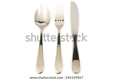 Metal fork, spoon and knife on white background - stock photo