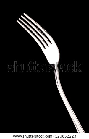 metal forks on black background - stock photo