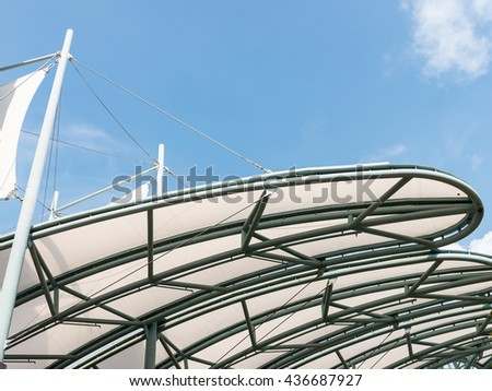 Metal frame of the canvas canopy above the walk way. - stock photo