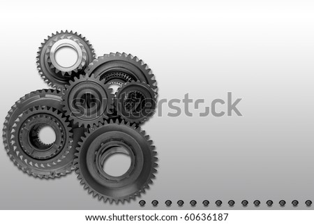 Metal gears on gray background - stock photo