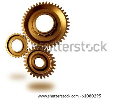 Metal gears on plain background - stock photo