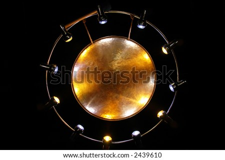 Metal gong against the black background - stock photo